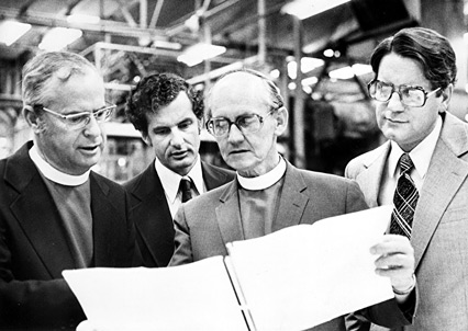 A 1978 photo of Bishop Robinson, centre) with proofs of An Australian Prayer Book (photo: Ramon Williams, Worldwide Photos)
