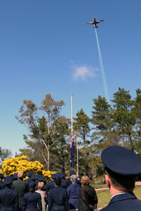 An RAAF A PC-9 Roulette aerobatic display aircraft performs a low-level  y-past during the 75th Anniversary Commemorative Service.