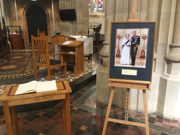 The condolence book and portrait standing in the Cathedral.