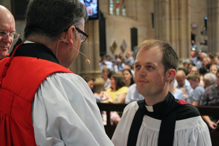 Philip Rademaker is ordained by Archbishop Davies as Bishop Edwards looks on