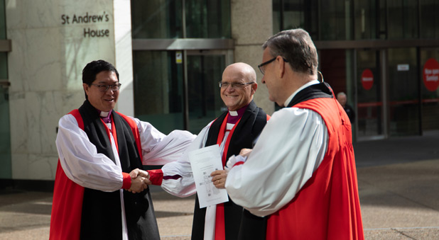 'Welcome' says fellow Bishop Peter Lin (left)