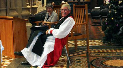 Bishop Forsyth tries out his plastic 'cathedral chair' while wife Margie looks on