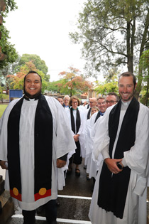 Waiting at the door - Armidale clergy on hand to greet the new bishop
