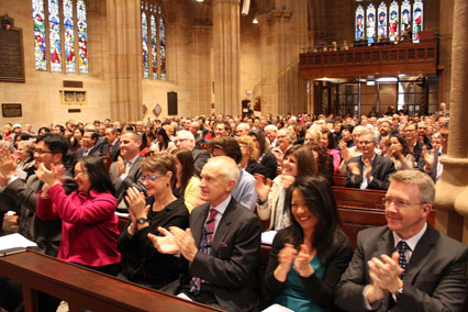 The congregation applauds as the new bishop is presented.