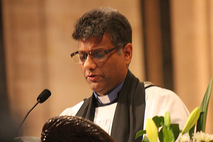 Dean Kanishka Raffel during a solemn moment in the service