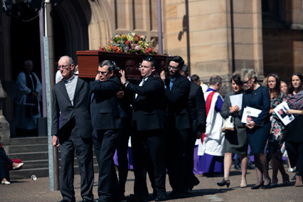 Sons Martin (front left) and Peter (front right) help carry the coffin from the Cathedral