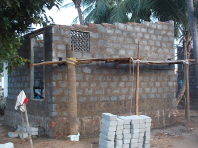 One of the eight brick houses currently under construction