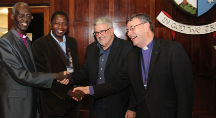 Congratulations: FCA Chairman Richard Condie is surrounded by guests at the launch event - Archbishop Wabukala of Kenya, Archbishop Ntgali of Uganda and Sydney Archbishop Davies