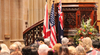US and Australian flags hung in front of the congregation