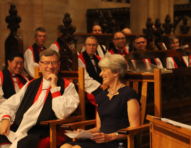 Archbishop and Mrs Davies listen to tributes