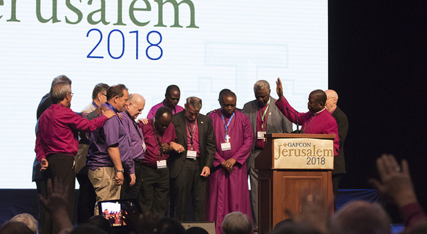 Members of the Primates council pray for the new Chairman and Secretary