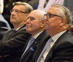 John Howard (centre) watches the 10th anniversary presentation with Generate Chairman James Millar (right) and Archbishop Davies. photo: Daryl Charles