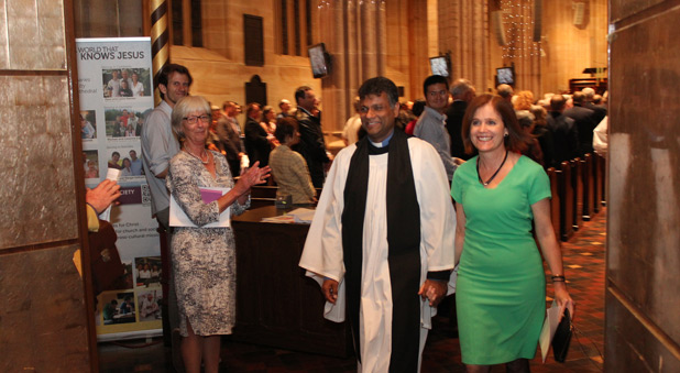 The new Dean and his wife Cailey leave the Cathedral to applause from the congregation.