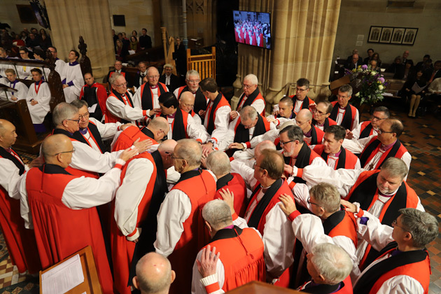 Bishops Lay hands on the new Archbishop