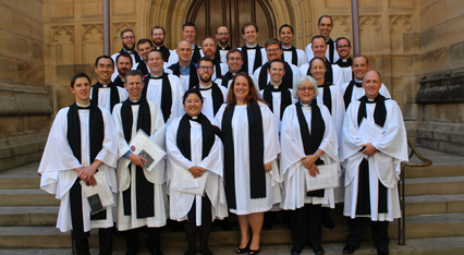 The 27 ordinands in a group picture on the steps of the Cathedral