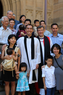 The Rev Alan Lam with the Archbishop and family and friends from Summer Hill parish.