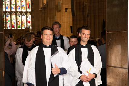 The newly ordained ministers emerge from the Cathedral led by Peter Blair and Gerard O'Brien