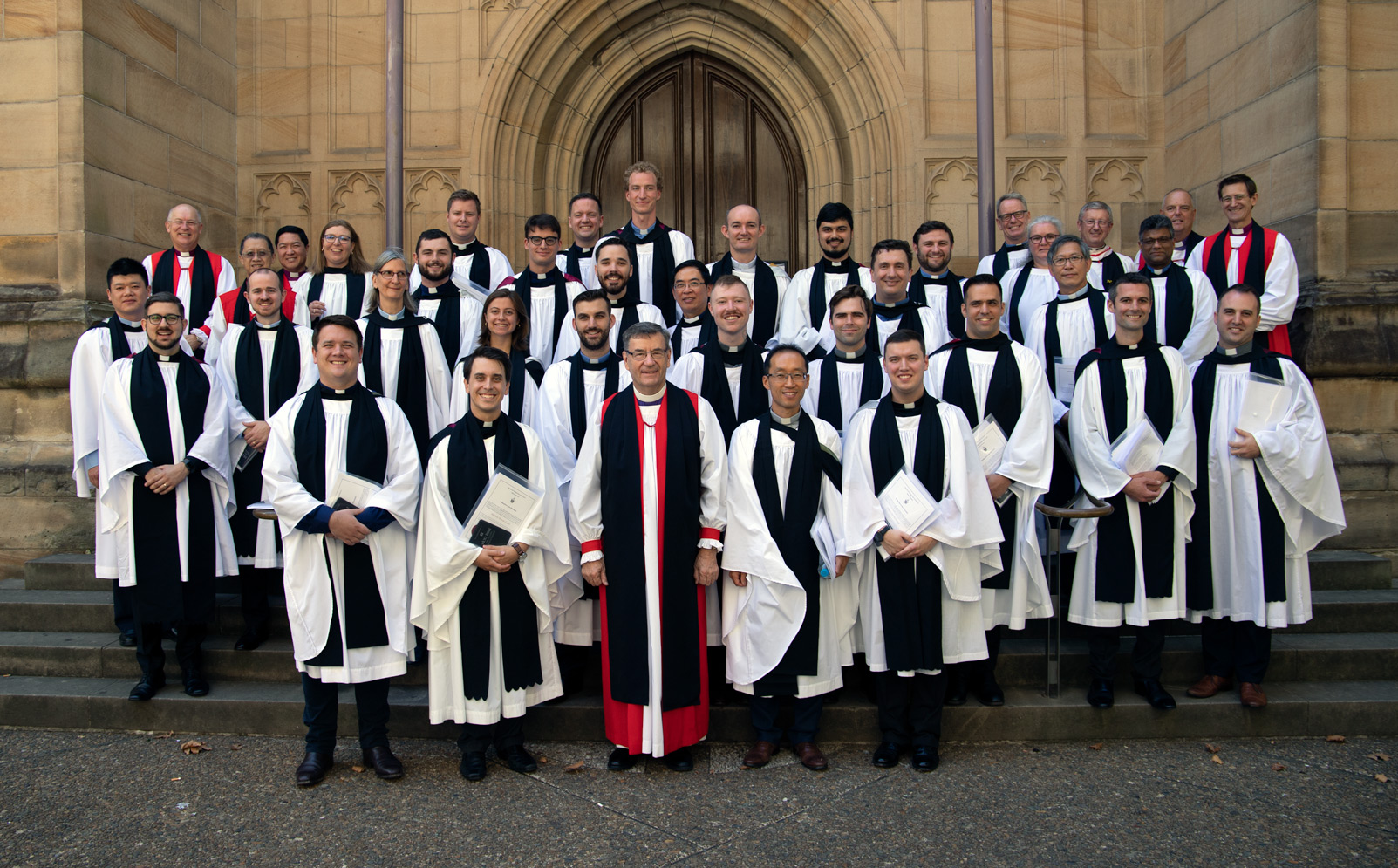 Ordinands and the Archbishop pose for the official photo on the steps of the Cathedral (right click to open a larger image)