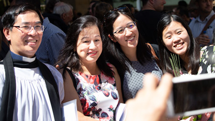 Photos everywhere: Un Hui Tay with relatives and friends including his daughter, Phyllis (second from right)