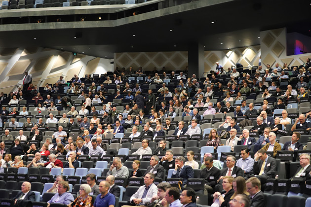 The Synod delegates begin deliberations.