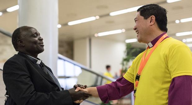 Bishop Peter Lin welcomes a Ugandan delegate